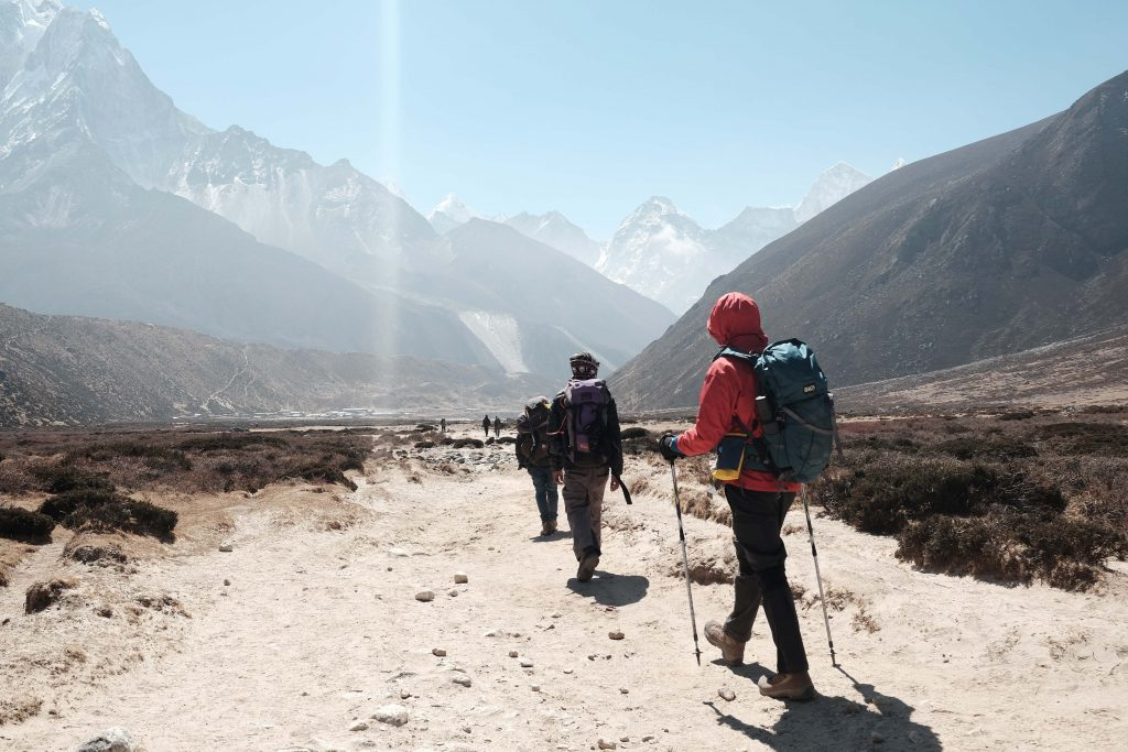 Image of trekkers following a natural trail through the Himalaya Mountains in Nepal.